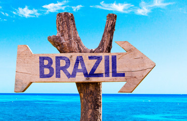 Brazil wooden sign with a beach on background