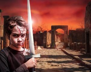 junger Krieger in apokalyptischer Landschaft
