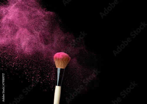 powderbrush on black background with blue powder splash - 79189717