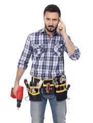 Handyman with toolbelt and drill