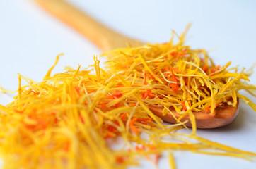 Saffron on wooden teaspoon