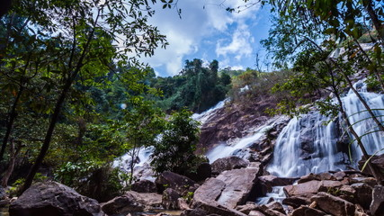 Timelapse of passing cloud and waterfall in Thailand