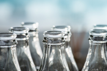 Clear glass bottles in the sun