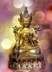 Statue of the Avalokiteshvara on bokeh background.