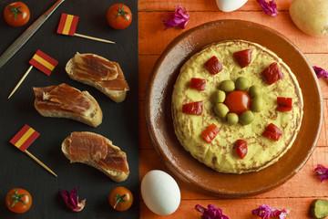 Spanish omelette and ham brochettes