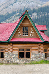 house with red roof on Bow Lake in Canada