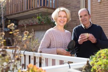 Elderly spouses in patio