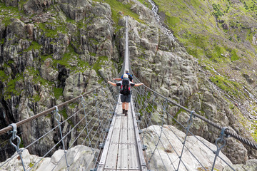 Trift Bridge, pedestrian-only suspension bridge in Alps. Canton