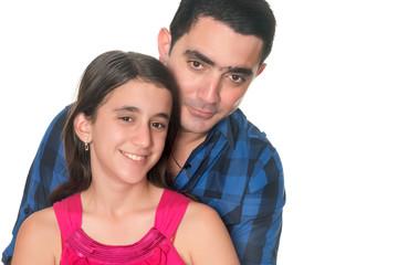 Hispanic man hugging her teenage daughter