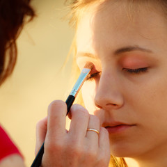 woman face applying eyeshadow eyes makeup.