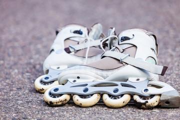 Closeup roller skates on asphalt.