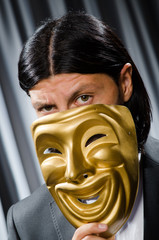 Funny concept with theatrical mask