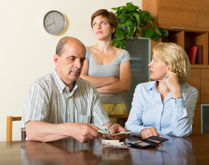 Adult daughter and parents with money