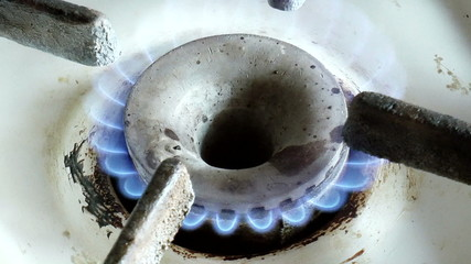 The video shows old gas burner with flame clousup