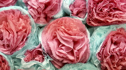 The video shows flowers made of paper