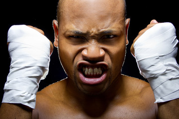 portrait of an intense black fighter holding fists up