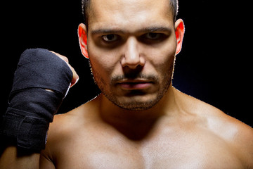 portrait of a latino mma fighter with intense expression