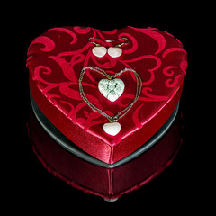 Heart shaped pendant on a Valentines candy box