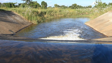 water flow down from weir crest to downstream irrigation canal
