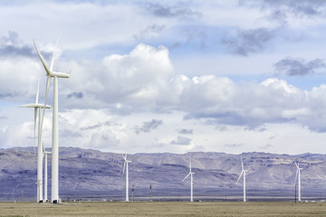 Mountains and wind turbines making electricity