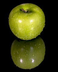 Crisp apple with a stem and water on it