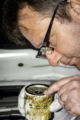 Mechanic inspects a used oil filter