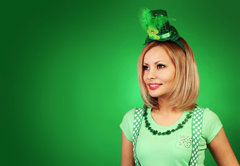 St Patrick's day Girl. Happy blonde young woman with hat