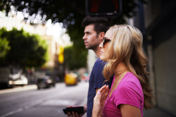 woman with her boyfriend walking in down town los angeles