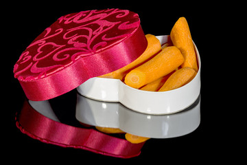 Carrots in a candy box used for Valentine's day