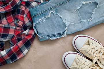 Checked shirt, jeans and shoes