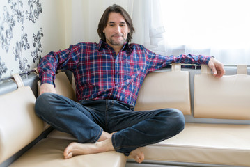 Man sitting in sofa at  home