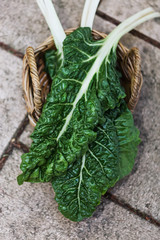 Organic silverbeet on a basket