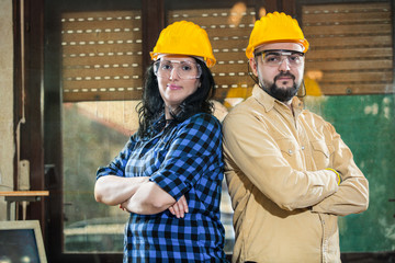 Woman and man posing together in the workshop