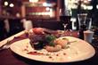 Leinwandbild Motiv glass of wine restaurant interior serving dinner