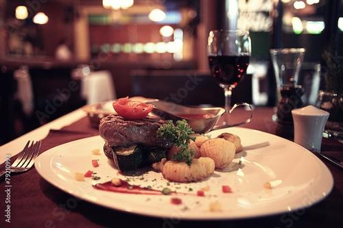 glass of wine restaurant interior serving dinner - 79210993