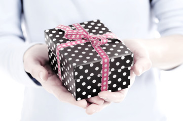 present box in a woman hand close up