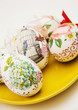 Decorated Easter eggs on the yellow plate