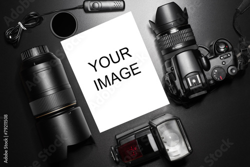 Camera equipment around a printed photo (blank space) - 79211508