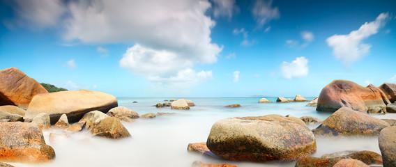 Panorama Seychelles lagoon with rocks long exposure