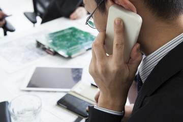 Men over the phone during a meeting
