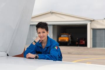 Young woman airplane pilot portrait.