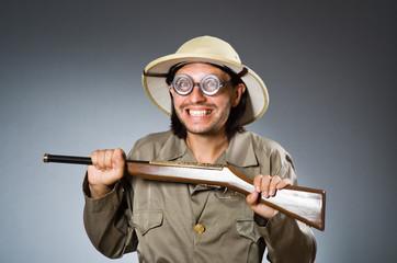 Funny safari hunter with rifle