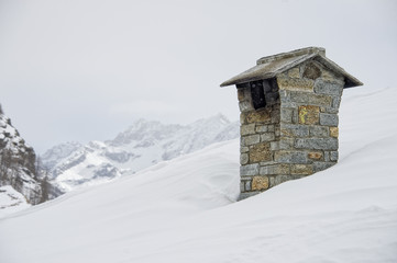 Winter time mountain house chimney