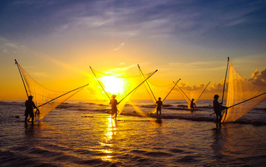 Fishermen fishing in the sea at sunrise in Namdinh, Vietnam