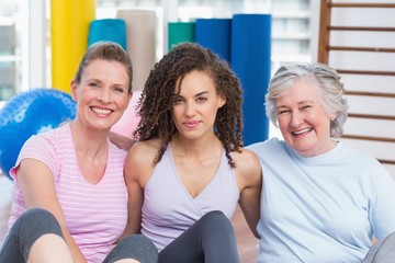 Portrait of female friends sitting in gym