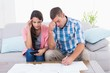 Worried couple calculating home finances