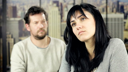 Woman angry with boyfriend at home feeling sad