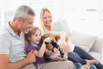 Parents looking at children playing video game
