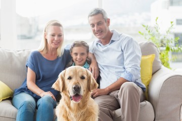 Family with Golden Retriever at home
