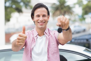 Man smiling and showing thumbs up